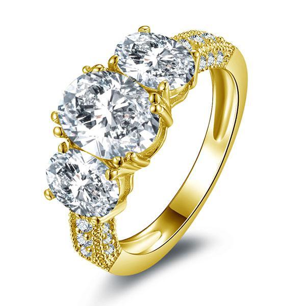 Italo Three Stone Golden Created White Sapphire Engagement Ring