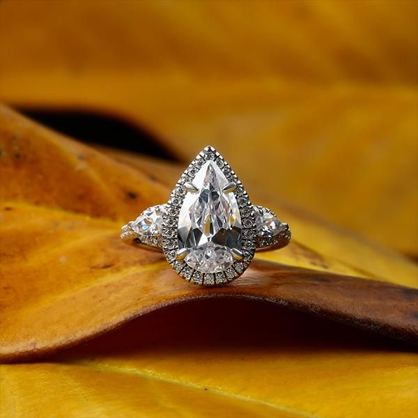 Pear Halo Three Stone Engagement Ring