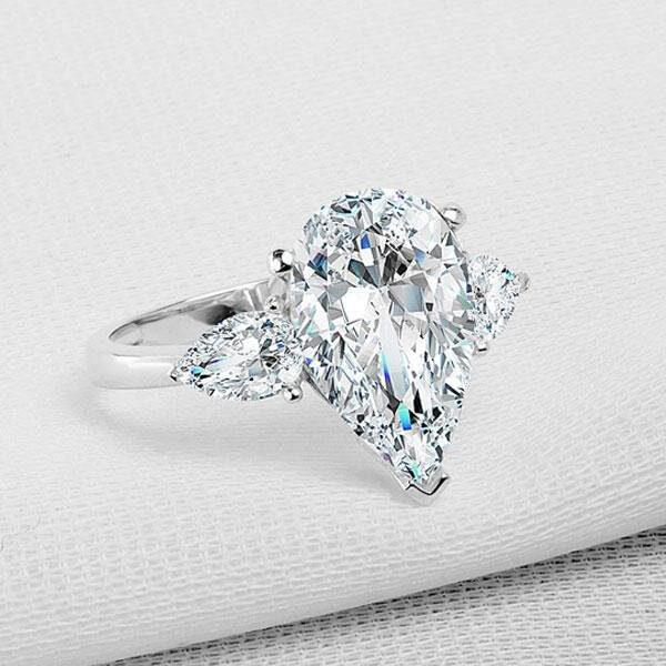 Pear Halo Engagement Ring With Fruitful Flare